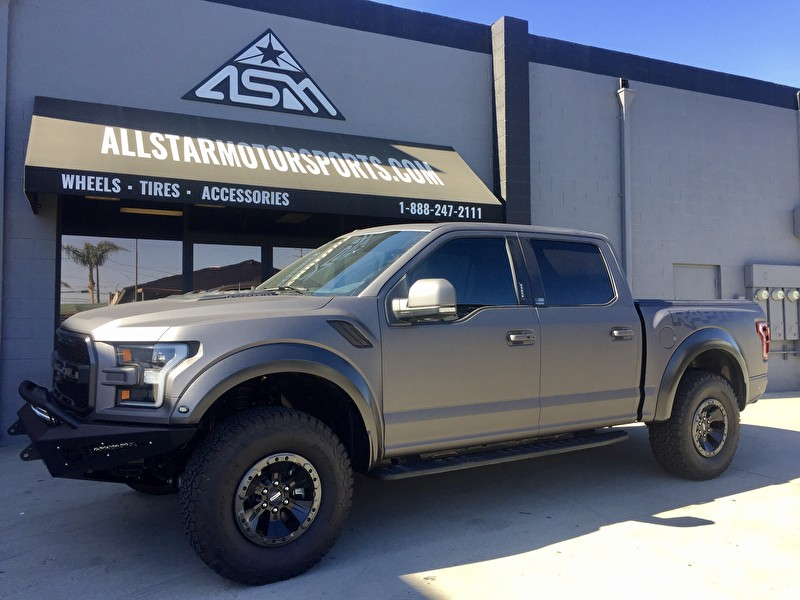 Custom 2017 Ford Raptor with Matte Gray Vehicle Wrap | Custom Bumpers and LED Lights Side Profile