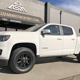 White Chevy Colorado with Ready Lift Level Kit | 17 Inch Moto Metal MO970 Black Milled Wheels and Toyo Open Country A/T 2 265/70R17 Tires