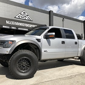 Silver Ford Raptor on Method Race Wheels Double Standard 17x8.5 Matte Black and BF Goodrich All Terrain T/A KO2 Tires
