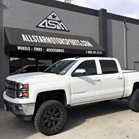 White Lifted Chevy Silverado | 22x10 Fuel D538 Maverick Black/Milled Wheels