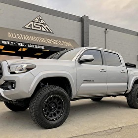 Silver Toyota Tacoma | Fox Suspension System | Method Grid 17 Inch Wheels on Toyo Open Country A/T 265/70R17 Tires