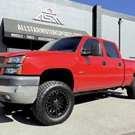 Red Chevy Silverado on 18x9 Black Rhino Madness with 285/65R18 Nitto Terra Grappler G2