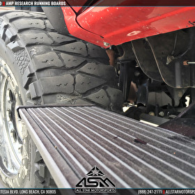 Chevrolet Silverado on Nitto Mud Grappler and AMP Research Running Boards