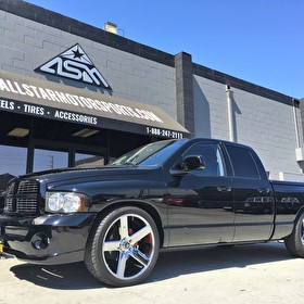Black Dodge Ram 1500 on 24 Inch DUB Baller Chrome 5 Spoke