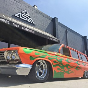 Custom Painted Wagon Slammed with Classic Torq Thrust Style Wheels