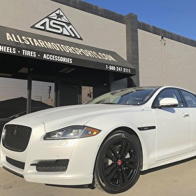 White Jaguar XJ Sedan | Blackout Package | Black Powder Coated Wheels