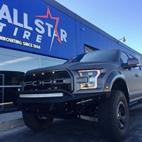 Custom 2017 Ford Raptor with Matte Gray Vehicle Wrap | Custom Bumpers and LED Lights